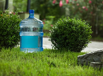 Water jug sitting in the grass